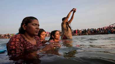 Hindu devotees take holy dip at the ganga dusshera