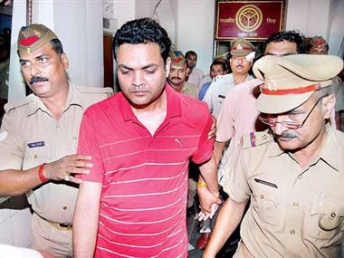 IAS suspended, held for molestation on train