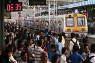 How many people take the Mumbai local train daily