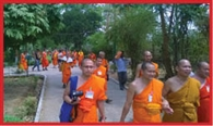 Bangkok University's 130-member team was led by the worship of Lord Buddha
