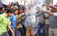 Statistics volunteers burned an effigy of CM