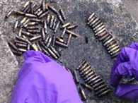 182 hand grenades and AK-47 bullets were found in pond