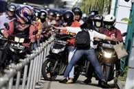 Jakarta woman becomes pavement hero
