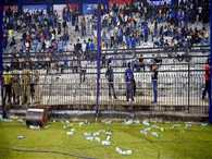 Spectators in Cuttack throw bottles to halt the match