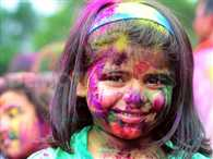People throng streets to celebrate Holi
