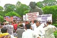 NDA leaders sit in protest at the Gandhi statue in the Parliament against corruption of Congress