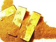 Gold futures down on weak global cues