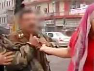Woman Grabbed The Collar Of Inspector