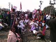 Hundreds of people gathered on the railway track in Jamalpur