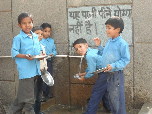 Student   washes their dishes after Mid day meal in Schools