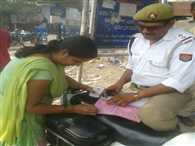 ASI registers challan without wearing helmet of his wife