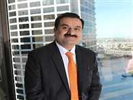 adani breaks into top 10 rich club