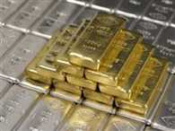 Gold recovers on global cues; silver remains weak