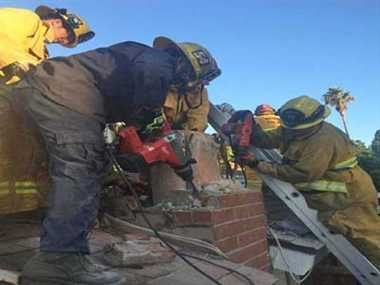 Woman rescued from chimney of lovers home in california
