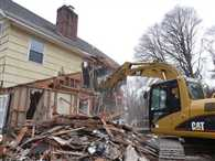 destroy own house by bulldozer