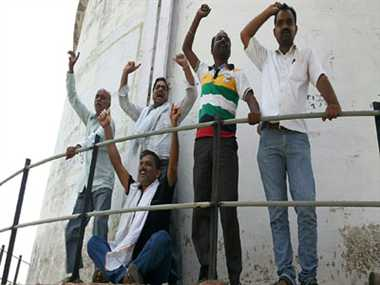leaders climbed at water Tower to protest electricity problem