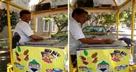 Bird hassles Indian street vendor for a lick of ice cream