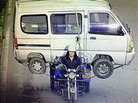 China motorist carrying a MINIBUS with tiny scooter