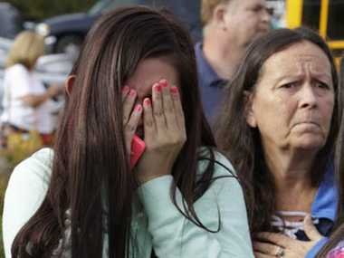 two died in firing by boy in cafeteria of school in america