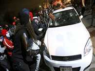 Gunshots echo as violence returns to Ferguson, protests across US
