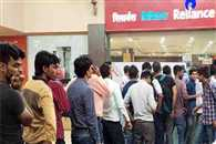 people line up in front of reliance jio stores