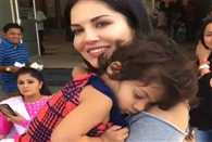A girl hugged to sunny leone and refused go to her mother