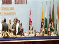 Modi and his Pakistani counterpart Sharif exchange pleasantries at the SAARC retreat in Nepal