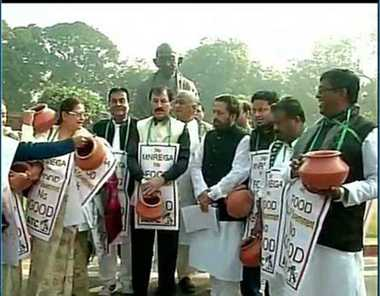 Delhi: TMC protest against proposed changes in MNREGA Scheme outside Parliament