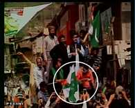 shabbir shah's supporters raise Pakistani flags at a rally in anantnag