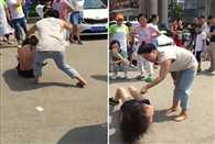 woman strips her husband's alleged mistress in public before violently slapping