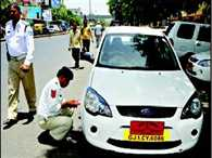 No titles, designations on number plates says gujarat high court