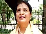 Pakistani sister Qamar Khan ties Rakhi to PM Modi