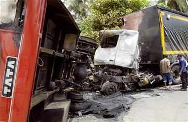 truck collide with container, 27 dead