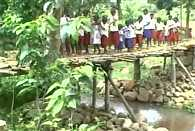 Children use this  temporary bridge to reach school