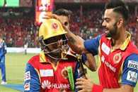 Virat Kohli gifts bat and gloves to Sarfaraz Khan