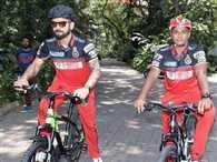 Virat Kohli gifts bat and gloves to Sarfaraz Khan