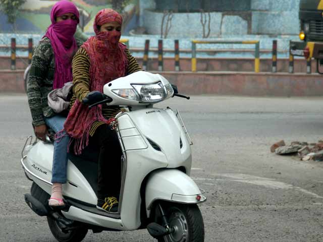 Image result for girls covering their face on scooters